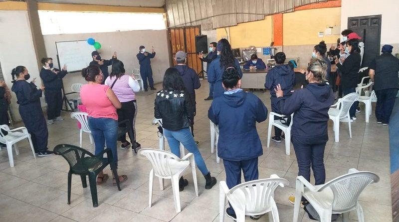 Comerciantes Mercado Cotocollao participan en taller violencia